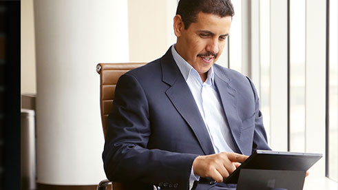 A man working on a tablet